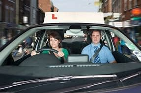 how many driving lessons are required by law uk